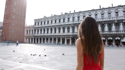 stock-footage-venice-woman-tourist-walking-on-san-marco-square-italy-smiling-happy-cheerful-multiracial-girl