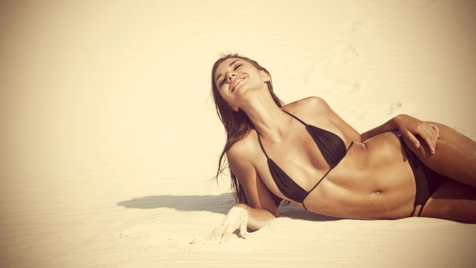 beautiful-tanned-woman-on-the-beach