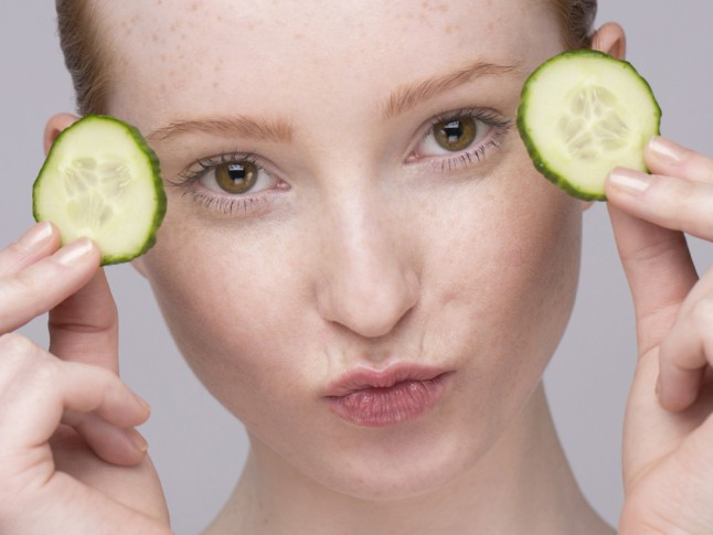 woman bags eyes cucumber